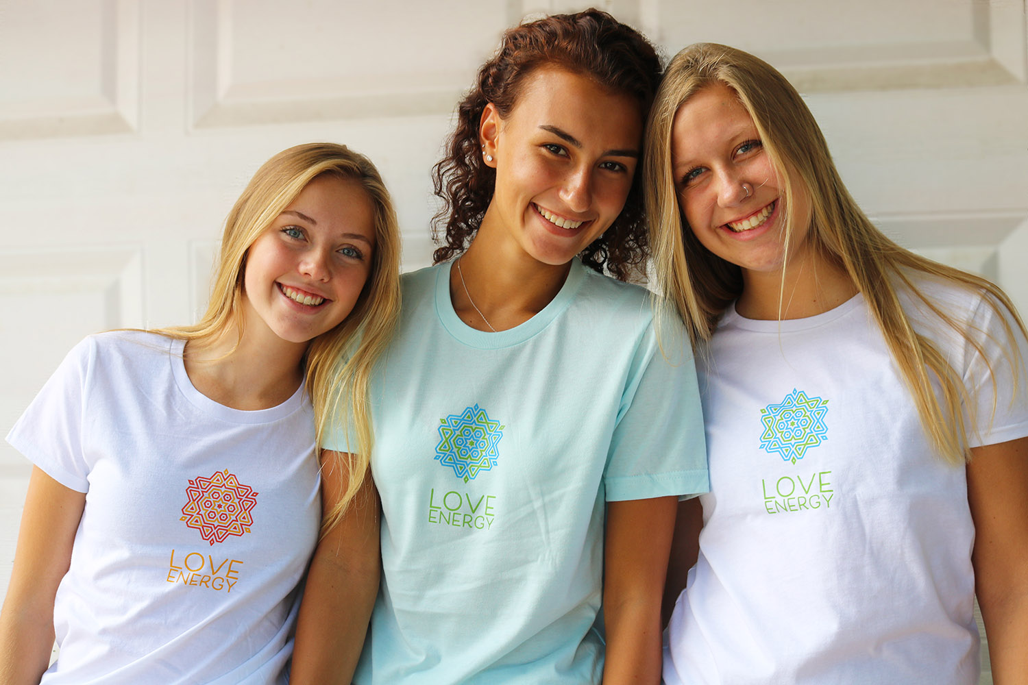 Three girls in Love Energy t-shirts